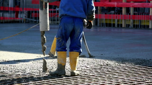 ms workers directing concrete onto the construction site - concrete stock videos & royalty-free footage