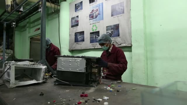 workers dismantle computer parts printers and keyboards at the attero recycling pvt facility in the raipur industrial area of bhagwanpur in roorkee... - e waste stock videos & royalty-free footage