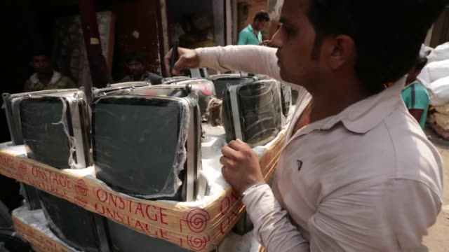 workers dismantle used computers and electronics in new delhi india on thursday june 18 2015 shots wide shot of pile of computers on the street shot... - e waste stock videos & royalty-free footage