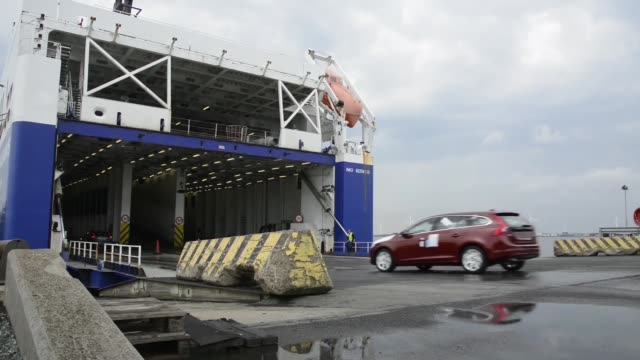 Workers drive new automobiles manufactured by Volvo Cars onto a cargo ship at the Port of Gothenburg in Gothenburg Construction vehicles manufactured...