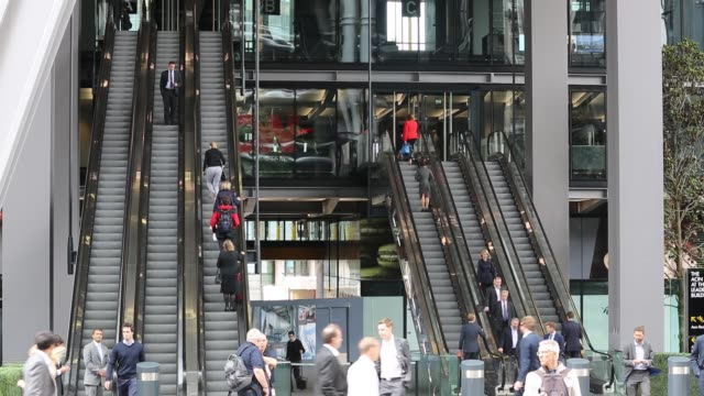 workers entering and leaving the new leadenhall building via the escalator in the city of london, united kingdom. - modern stock videos & royalty-free footage