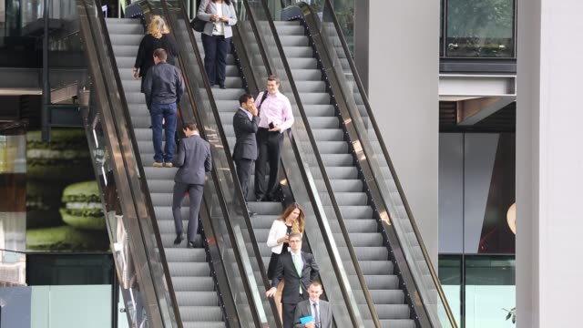 workers entering and leaving the new leadenhall building via the escalator in the city of london united kingdom - human age stock videos & royalty-free footage