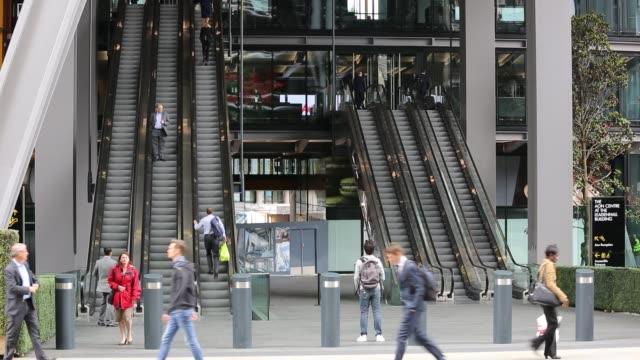 workers entering and leaving the new leadenhall building via the escalator in the city of london, united kingdom. - staircase stock videos & royalty-free footage