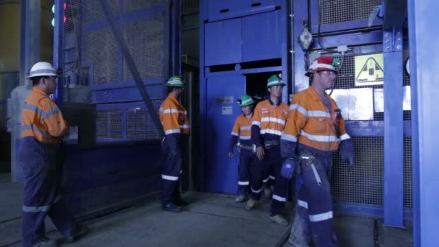 Workers exit an elevator from a deep mine shaft at the end of a shift at the Oyu Tolgoi copper gold mine jointly owned by Rio Tinto Group's Turquoise...