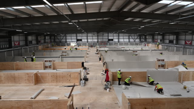workers fit out the indoor training centre at parc y scarlets as a field hospital on march 30 in llanelli, wales. parc y scarlets, home of scarlets... - temporary stock videos & royalty-free footage