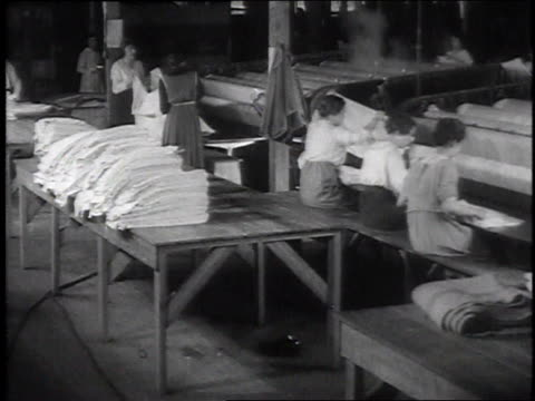 stockvideo's en b-roll-footage met w workers folding sheets / camp sherman chillicothe ohio united states - chillicothe