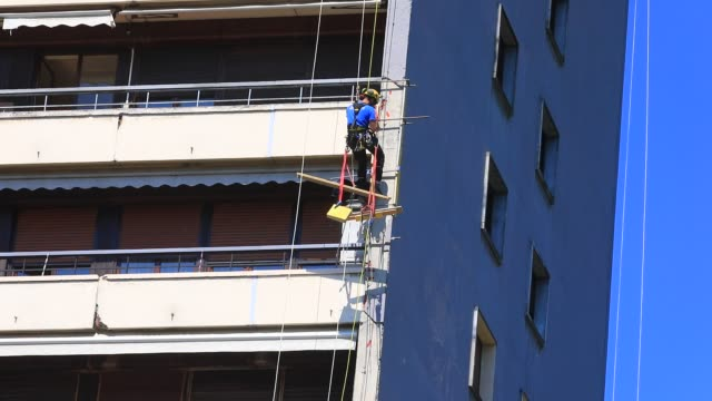 "workers goes down a rope on the residential skyscraper ""le centenaire"" during a facade renovation on may 19, 2020 in chambery, france. - high up stock videos & royalty-free footage"