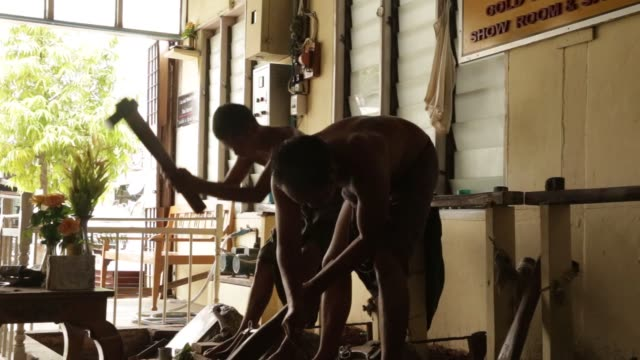 workers hammer gold leaves at the king galon gold leaf workshop in mandalay, myanmar, on sunday, june 11, 2017 - gold leaf stock videos & royalty-free footage