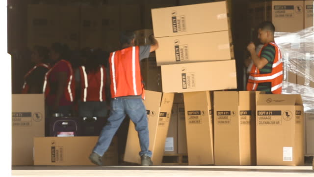workers handle shipping boxes, wide shot - handle stock videos and b-roll footage