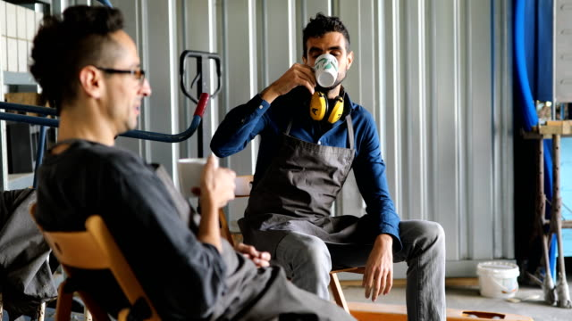 workers having a coffee break in the workshop - manufacturing occupation stock videos & royalty-free footage
