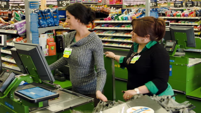 stockvideo's en b-roll-footage met workers in a walmart store at work in the store on february 19 2015 in miami florida the walmart company announced thursday that it will raise the... - wal mart