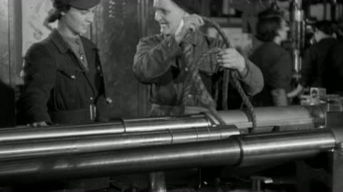 b/w montage workers in a world war ii munitions factory delivering a finished artillery barrel via a winch, with other workers including those in office watching / england, united kingdom - world war ii stock videos & royalty-free footage