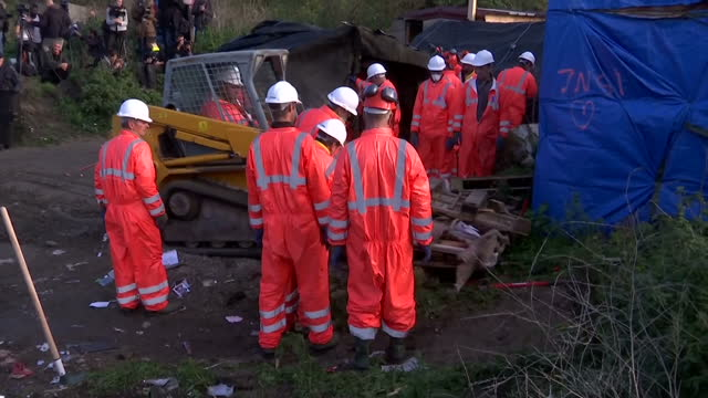 workers in calais today began dismantling the makeshift camp that has become a symbol of europe's refugee crisis they tore down the plywood cabins... - makeshift stock videos and b-roll footage