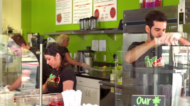 MS PAN workers in juice bar preparing juices and smoothies