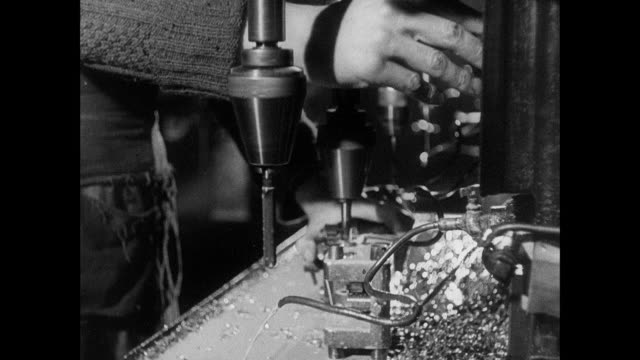 montage workers in munitions factory manufacturing rifles and ammunition / united kingdom - munition stock-videos und b-roll-filmmaterial