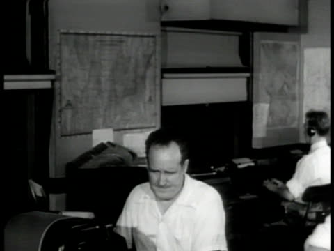 workers in news room. vs man at teletype 'here's a hot one,' others crowd around, editor tearing bulletin. editor at desk making telephone call 'get... - journalist stock videos & royalty-free footage