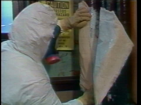 workers in protective clothing remove asbestos from a building. - asbestos stock videos & royalty-free footage
