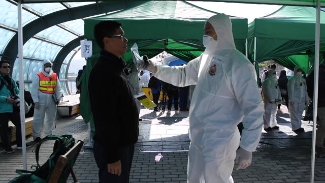 Workers in protective suits decontamination tents and a staged evacuation were part of a large scale nuclear emergency drill carried out Wedneday on...
