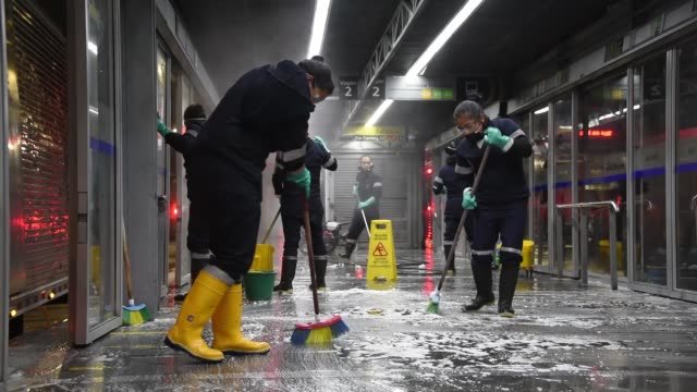 workers in protective suits disinfect and clean a public transport bus station on march 13 2020 in bogota colombia president of colombia ivan duque... - cleaning stock videos & royalty-free footage