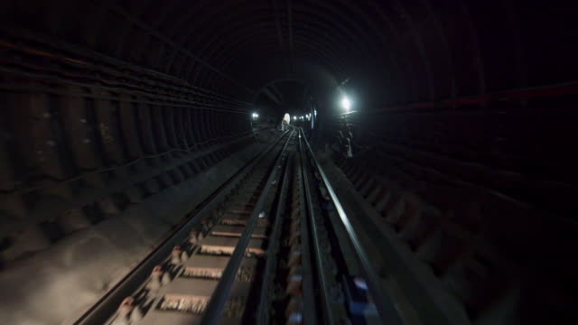 ws pov workers in subway tunnel / london, england, united kingdom - zugperspektive stock-videos und b-roll-filmmaterial