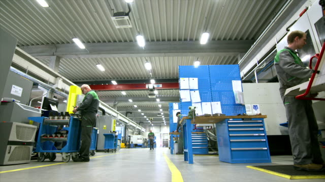 DS Workers In The Manufacturing Plant