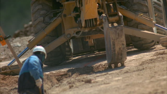 ms pan tu td workers in trench near loader and excavator on construction site / cedar park, texas, usa - cedar park texas stock videos & royalty-free footage