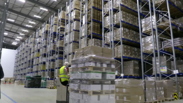 workers in warehouse packing up ppe personal protective equipment for hospitals to help in fight against coronavirus pandemic - packing stock videos & royalty-free footage