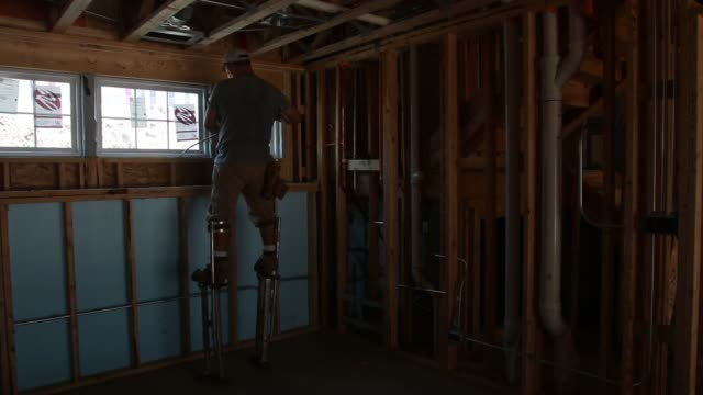 workers including bricklayers insulation installers spraying foam construction materials at a construction site for single family townhomes in... - caulk gun stock videos and b-roll footage
