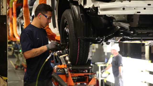 workers inside the subaru of indiana automotive, inc. manufacturing plant in lafayette, indiana on may 25, 2016. shots: ecus of wheels bearing logo... - subaru stock videos & royalty-free footage
