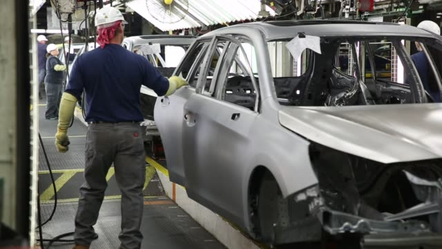 workers inside the subaru of indiana automotive, inc. manufacturing plant in lafayette, indiana on may 25, 2016. shots: shot of workers moving car... - subaru stock videos & royalty-free footage