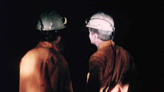 MONTAGE Workers inspecting underground in mine / England, United Kingdom