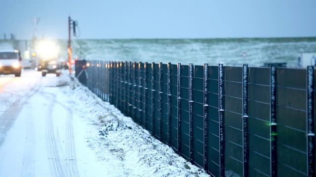 workers install a portion of a fence along the danish border to germany that is meant to stop wild boar from entering denmark on january 31, 2019... - fence stock videos & royalty-free footage