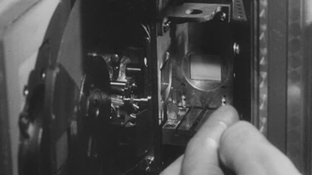 1951 montage workers installing a prism and lens into a color camera / united kingdom - prism stock videos & royalty-free footage