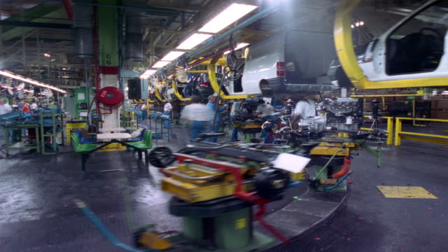t/l, ms, workers installing engines at car assembly line, dagenham, england - line stock videos & royalty-free footage