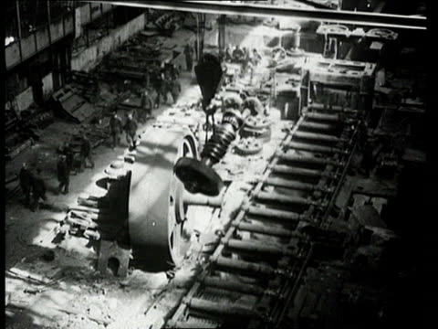 vídeos de stock e filmes b-roll de workers installing rolling mill in automobile plant during reconstruction of workshops/ workers using crane to lift hot metal and move it along... - 1947