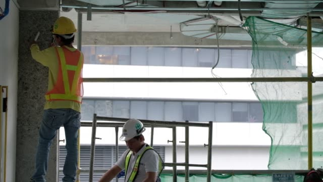 Workers labor at an Ayala Land Inc's development under construction in the Makati district of Manila the Philippines on Wednesday Oct 25 A worker...