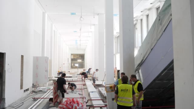 workers lay pipes that will run underneath the floor in the humboldt forum on june 17 2019 in berlin germany the humboldt forum will occupy the... - berliner stadtschloss stock-videos und b-roll-filmmaterial
