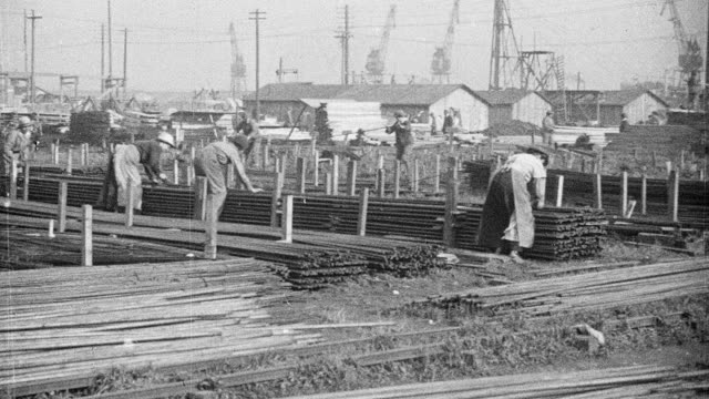 montage workers laying out the materials for a ship at a shipyard / hempsted, england, united kingdom - 1918 stock videos & royalty-free footage