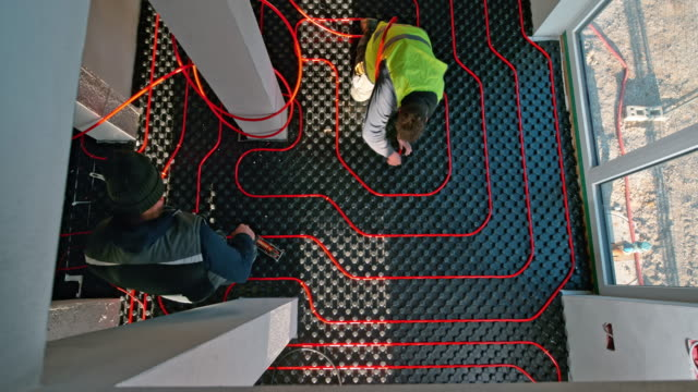 time-lapse workers laying red floor heating pipes - installing stock videos & royalty-free footage