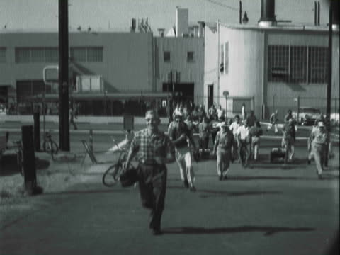 b/w workers leaving plant at the end of shift / united states - b rolle stock-videos und b-roll-filmmaterial