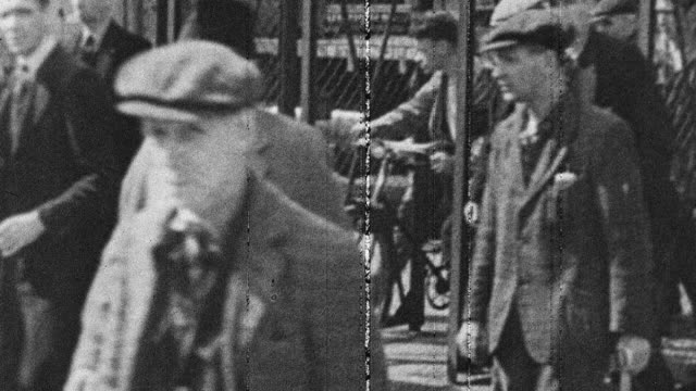 1944 montage workers leaving wartime factory after work / scotland, united kingdom - leaving stock videos & royalty-free footage