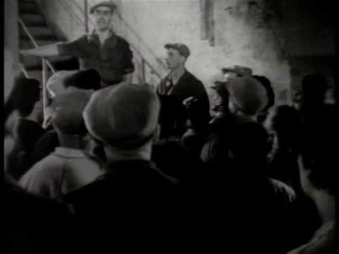 workers listening to male standing on steps workers talking in group large group of people outside factory - civilian stock videos and b-roll footage