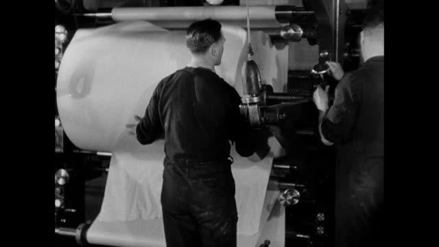 montage workers load giant spools of paper onto printing rigs / london, england, united kingdom - printing press stock videos & royalty-free footage