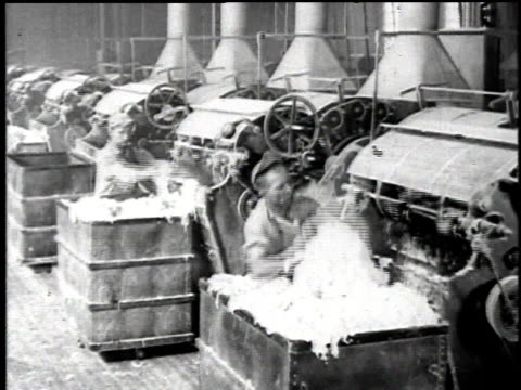 1921 montage workers loading and a variety of factory machines processing asbestos fiber / waukegan, illinois, united states - 1921 stock videos & royalty-free footage