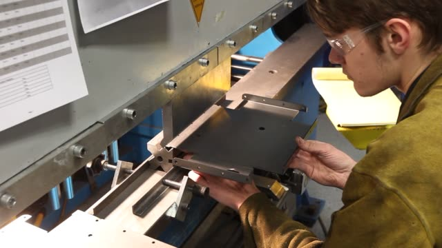 stockvideo's en b-roll-footage met workers make brackets to go into chevrolet express van's when they are converted to electric power at the via electric motors labs in orem utah on... - orem utah