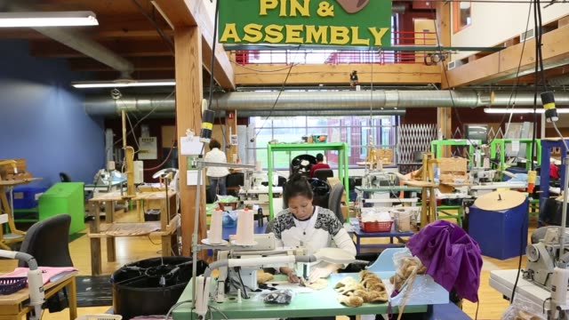 workers make teddy bears at the vermont teddy bear factory in shelburne, vermont, november 13, 2015 shots: employees sew together fabric to make the... - teddy bear stock videos & royalty-free footage