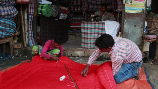 Workers makes worm quilt to sell them during cold wave hits in Dhaka Bangladesh on January 08 2018 The cold wave continues to disrupt life across the...
