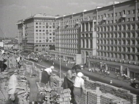 workers making building audio / moscow, russia - anno 1935 video stock e b–roll