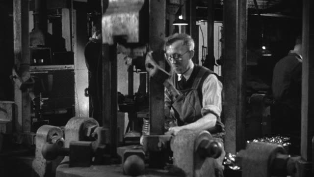 1948 montage workers making cutlery in a factory using stamping, grinding, and cleaning machines / sheffield, england, united kingdom - sheffield stock videos & royalty-free footage