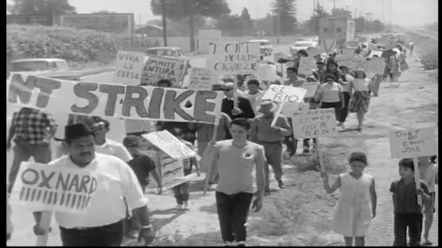 vídeos de stock, filmes e b-roll de workers march to protest increase in rent in their labor camps - migrant worker